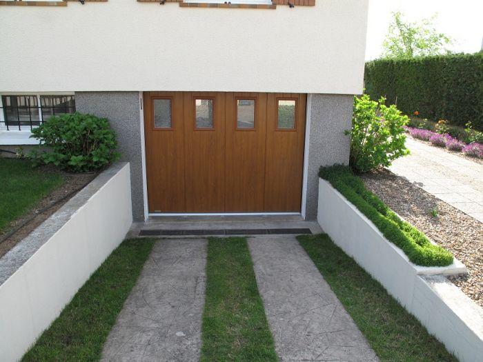 GST Rénovation - Nouvelle porte de garage sectionnelle vue de l'extérieur 2