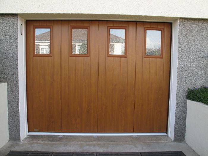 GST Rénovation - Nouvelle porte de garage sectionnelle vue de l'extérieur
