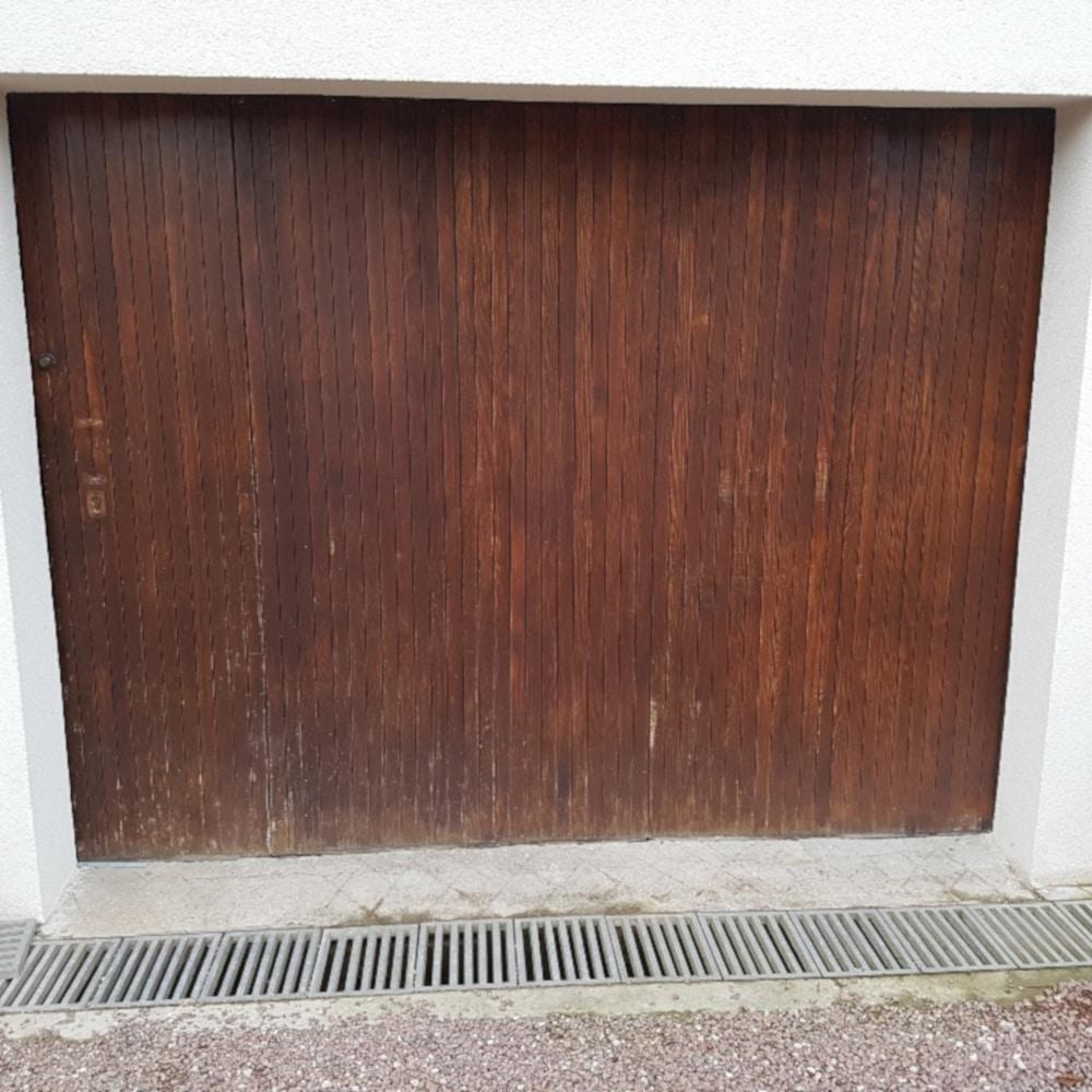 GST Rénovation - Inspection de l'ancienne porte de garage